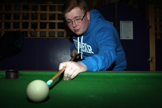Cue-ing up for a career in politics... James Savage at the Bridge Centre in Killyleagh during a youth club night.