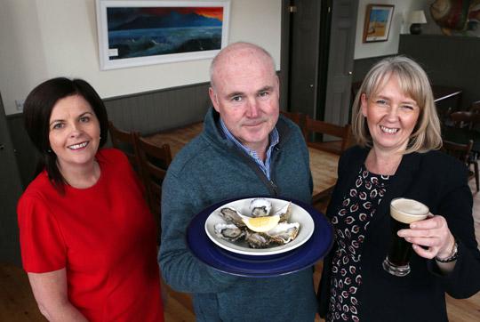 Robert McCoubrey, owner of the Mourne Seafood Bar, with Karen Hoey, Business Manager at Danske Bank and Oonagh Murtagh, Head of Danske Bank's Business Centre in Belfast.