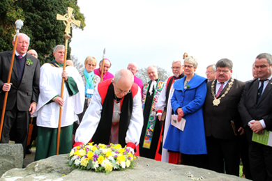 The Archbishop of Cantebury Justin Welby lays a wreath on the grave of St Patrick.