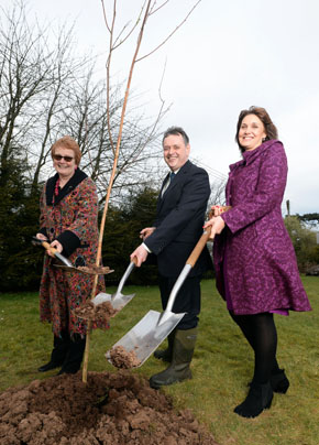 SERC DIG DEEP: SERC MBE award recipients Alice McDaniel, former Art and Design lecturer, Irene Megaw, Associate lecturer, and William Greer, Head of SERC's Training Organisation planting trees in the Holywood campus gardens to celebrate their contribution to further education in Northern Ireland.