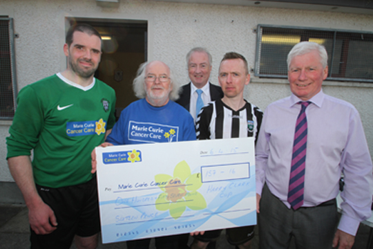 Bonny Brown, Marie Curie Cancer Care Drumaness representative, raised £157.16 at half-time in a collection. Pictured are team captains Conor Stratton, (Castlewellan) and Felix Valentine (Newcastle II's) with Robert Hayworth, Newcastle League chairman, and Frank McClean, League Vice Chairman.
