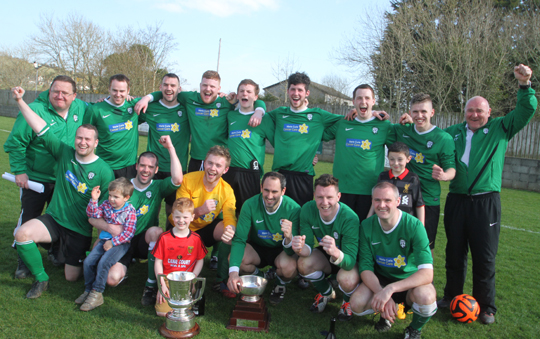 The winners: Castlewellan FC celebrate with the Harry Clarke Cup.