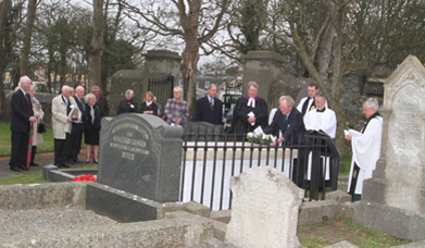 Ptere Acheson lays a wreath on the grave of Charles Sheils at St Anne;s Church in Killough in the redidication ceremony following the restoration of the family tomb.