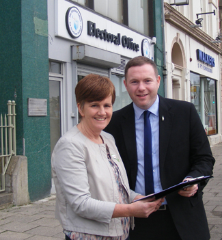 Chris Hazzard MLA, South Down Sinn Féin Westminster election candidate, with his election agent, Caitriona Ruane MLA at the Electoral Office in Banbridge.