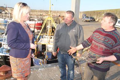 NI Fisheries MInister at Ardglass harbour talking to Karen skipper Paul Murphy and owner Simon Wills.
