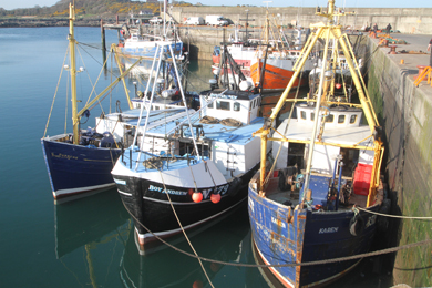 The Karen docken against the wall at the quayside in Ardglass harbour.