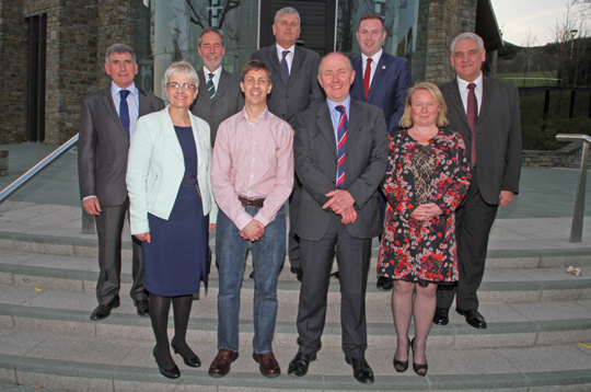 The seven South Down Westminster election candidates with debate chairmen Stephen Patton and Paul Symington, front centre. Back row, Harold McKee (UUP), Martyn Todd (Alliance), Jim Wells (DUP), Chris Hazzard (Sinn FŽin), Henry Reilly (UKIP).  Front row, Margaret Ritchie (SDLP) and Felicity Buchan (Conservative).