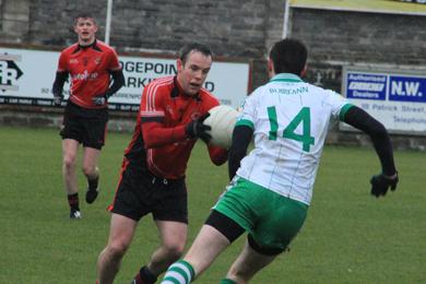 Rostrevor's Jarleth Farrell in action against Burren.