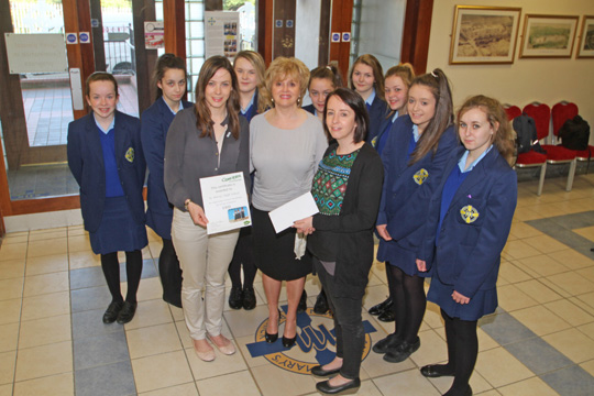 Pupils from St Mary's High School present cheques to Lisa Wilson, Concern Community Fundraiser  and Rosie McCreanor, area fundraiser for Trocáire.