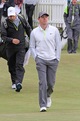 Rory McIlroy walking over to the first tee box.