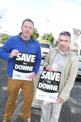 Chris Hazzard MLA and Councillor Patrick Clarke on the white line protest in Castlewellan.