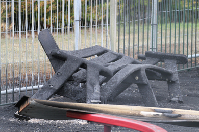 The intense heat and fire destroyed park benches nearby.