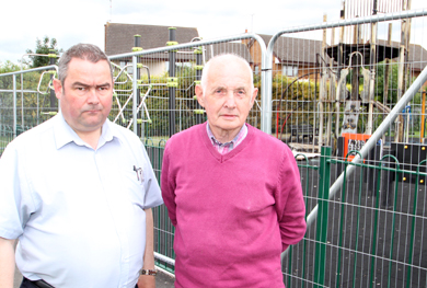 Fenced off: the Crossgar playpark is now out of bounds following a weekend fire which destroyed a substantial part of the facility. Pictured looking over the damage are Cllr Terry Andrews and Par Ward, DRAP board member.