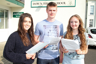 Celebrating were Rebecca Guiney, Mark Hanna and Georgina Majury. They were top students with five A* grades at the Down High School.