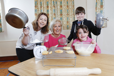 Adrienne Cockram, Senior Branch Manager Danske Bank Downpatrick and Isabel Kelly, Chair of Ballee & District Group with Ellie Magee (6) and Adam Jenner (10) both from Ballee & District Community Group.