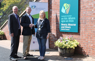 PCSP Chair Cllr Mickey Larkin, centre, with Newry Mourne and Down Chief Executive Liam Hannaway and Chairperson Cllr Naomi Bailie pictured at the Council offices in Monaghan Row in Newry.