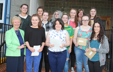 St Mary's High School Vice Principal Rosemary Cunningham with some of the successful pupils at the school after receiving their A Level results.