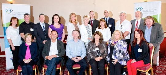 The NMD PCSP members: front (l-r): Shirley Burden, DoJNI; Councillors Willie Clarke and Mickey Larkin; Grace McQuiston and Fiona Stephens Independent Members (IM); and Paddy Rooney-White, NIHE. Back (l-r): Sheila Simons, SE Trust; Dan McEvoy, IM; Ferghal O'Brien, SHSCT; Jude Cumiskey, IM; Roising Lecky, PBNI; Coucillor Kate Loughran; Chief Inspector Andrew Freeburn, PSNI; Audrey Byrne, IM; Superintendent Simon Walls, PSNI; Martin Fahy, IM; and Councillors Harry Harvey and Brian Quinn.