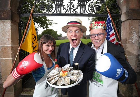 Compere George Shea, from New York with World Oyster Eating Champion Colin Shirlow and this years  opponent Michelle Lesco, a 31 year old teacher who has travelled all the way from Arizona, USA to try and  take his crown.