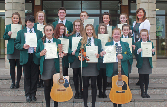 Successful music students at St Malachy's High School with Mrs Cora Magee, Head of Music.