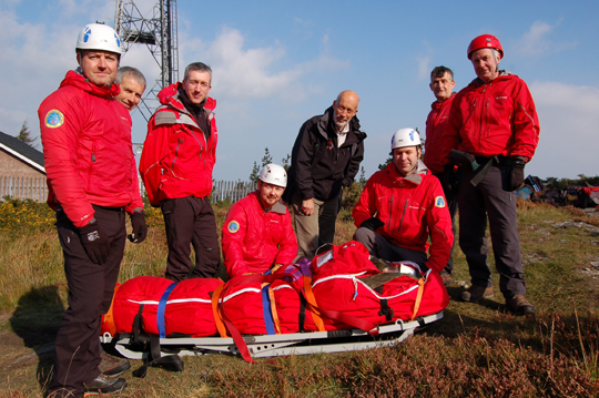 Minister David Ford looks over the rescue procedures of the Mourne Mountain Rescue Team.