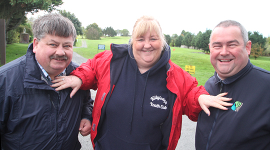 Keeping order between councillors Billy Walker and Terry Andrews before the duel on Bright Castle Golf Course is Michelle Hagan, Killyleagh Youth Club.