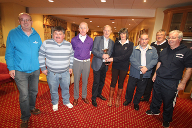 Liam Hannaway, Chief Executive of Newry Mourne and Down District Council presents Barbara Ennis with the tropy for highest scoring lady golfer. Pictured are Brian Patterson. volunteer with Down And Lisburn Alzeihmers group, Cllr Billy Walker, Arnie Ennis, Bright Castle Golf Course owner, Cllrs Terry Andrews and Michael Carr (Captain of Warrenpoint Golf Club), and Chris Hagan, Killyleagh Youth Club.