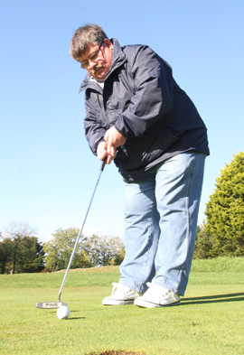 Cllr BillyWalker strokes the ball into the hole for a victory over Terry Andrews.