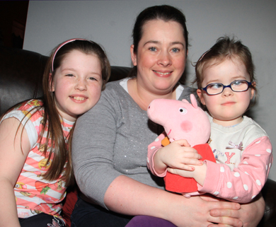 Caiomhe Burns (3), right, with her sister Cara (13) and her mother Deirdre at home in Kircubbin.