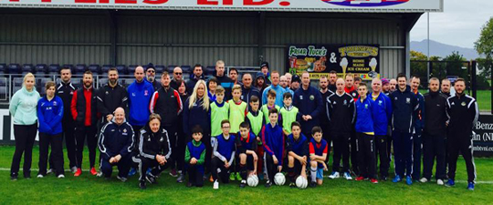 Swansea FC coaches and participants at the Warrenpoint Town FC ground.