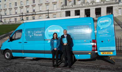 Jom Wells MLA pictured beside the Cancer Focus bus at Stormont.
