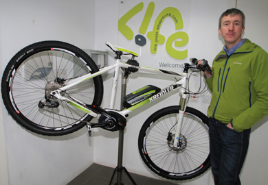 Martin McMullan with a Kreidler electric bicycle.