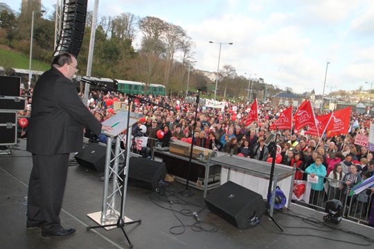 Eamonn McGrady, Chairman of the Down Community Health Committee, addresses the 20,000 strong rally in Downpatrick last year and called for full services to be restotred to the Downe Hospital.