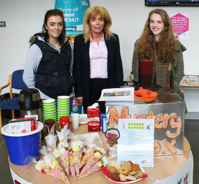 SERC Travel and Tourism students Jessica McComb from Killyleagh and Abigail Emerson from Downpatrick who raised £204 for Upskilling Uganda at the trade fairs. The students are with SERC Enterprise Manager Geraldine Boden.