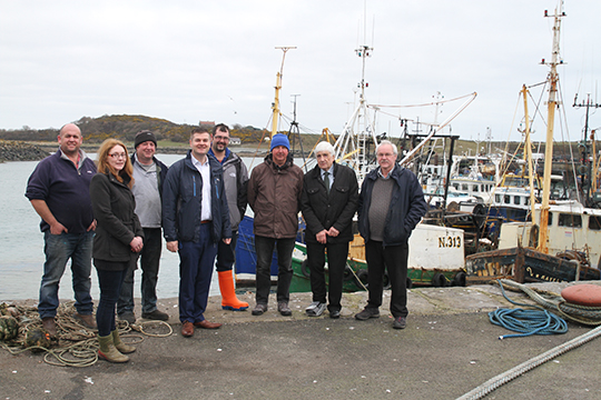 Collie Briggs, skipper, Marianne McGirr, fishwife, Simon Wills, boat owner, with SDLP South Down election candidate Councillor Colin McGrath, Marty Johnston Jnr, East Coast Seafoods, Basil Wills, boat owners, Councillor Dermot Curran, and Jim Masson, stakeholder group.