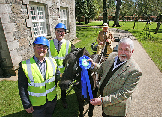 EVERYONE A WINNER: Albert Titterington welcomes Betterhomes Group as title sponsor of the 2016 Irish Game Fair & Fine Food Festival at Shanes Castle. Setting the mood for (left) David Boyd and Gary Sinnerton from Betterhomes is Great Game Fair Operations Director, Edwin Dash from Katesbride, with pony Jake.