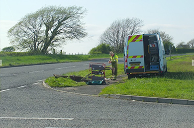 A BT telephone engineer spices telephone cables after thieves dug up the road and tried to remove the copper wire.