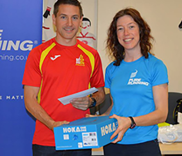 Belfast Hill: Paul Burns receives his winners prize from Pure Running's  Catriona McCorkell after Saturday 's race.