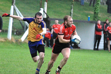Action in the match between Rostrevor and Tullylish.