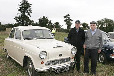Ballykinler men PJ Doran chats to Malachy Clendinning, the owner of the 1954 Austin Cambridge.