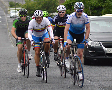 Shimna Wheelers Charlie Houston in the middle of the peloton