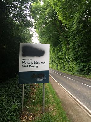 A bilingual sign near Ballyward on the Castlewellan - Banbridge Road has been sprayed over.