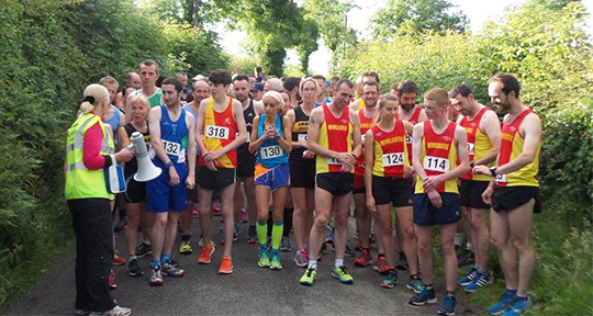 runners at the start of the Loughinisland 5.05 miles race on Wednesday receive last minute instructions from Mags Mathieson.