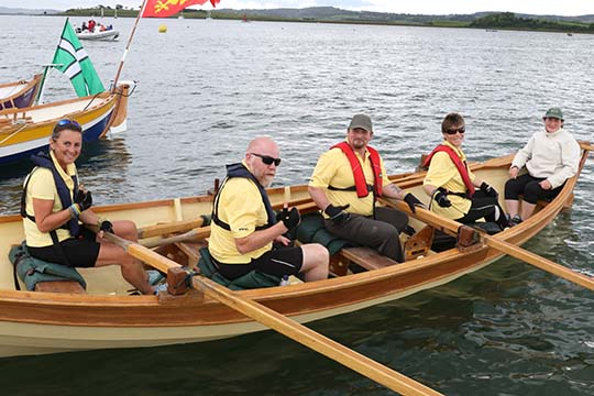 Dundrum rowers in their skiff getting ready for a race in Skiffie Worlds 2016.