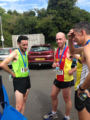The top 3 men in Saturday's Killyleagh Half Marathon in reflective mood at the end. (L to R) Aaron McGrady 3rd, Jonathan Scott 2nd and Neil Carty 1st.