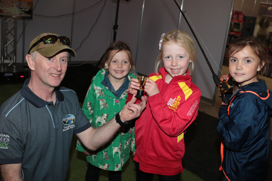 Erin Moore from near Downpatrick won a cup at the fishing simulator for landing a prize catch.