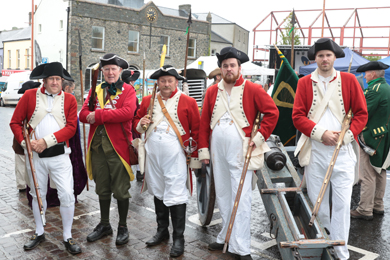 Redcoats from the Living History Ireland group pose fro a photo in the Ballynahinch Harvest and Fine Food Festival just before the re-enactment of the Battle of Ballynahinch.