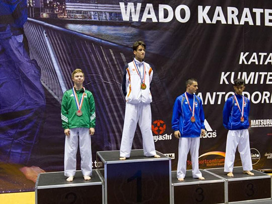 Ryan McEvoy pictured left on the podium collecting his silver medal in the WIKF championships in Rotterdam.