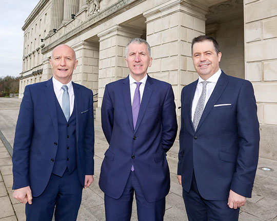 Colin Neill of Hospitality Ulster, Finance Minister Máirtin Ó Muilleoir and NIIRTA's Glyn Roberts at Stormont today for the announcement of the Rates Plan.