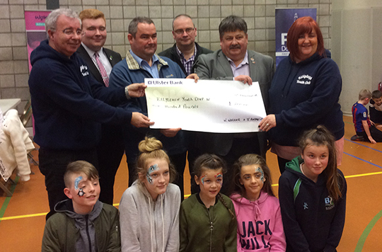 The Killyleagh Drop in Receives a cheque from Councillors Billy Walker and Terry Andrews.